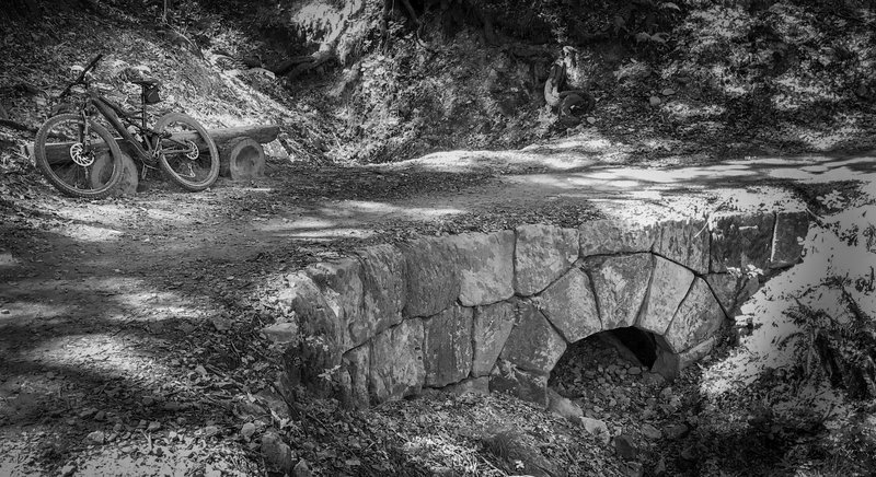 Rock bridge on John Nicolas Trail. The trail is noted for it's excellence in design and the nice architectural/landscape additions such as this bridge and the benches at various locations such as the viewpoint.