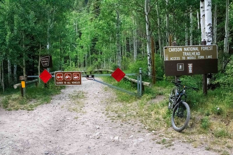 Middle Fork and Lost Lake trailhead. The first couple hundred feet crosses a public right of way across private property, don't be deterred by the gate ~ there is an entrance on the left for bikes and hikers.