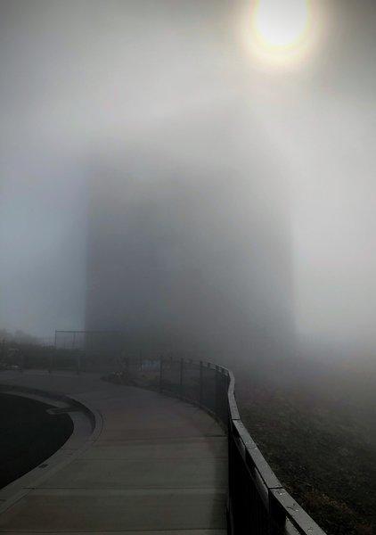 Mount Umunhum radar tower in a cloud.