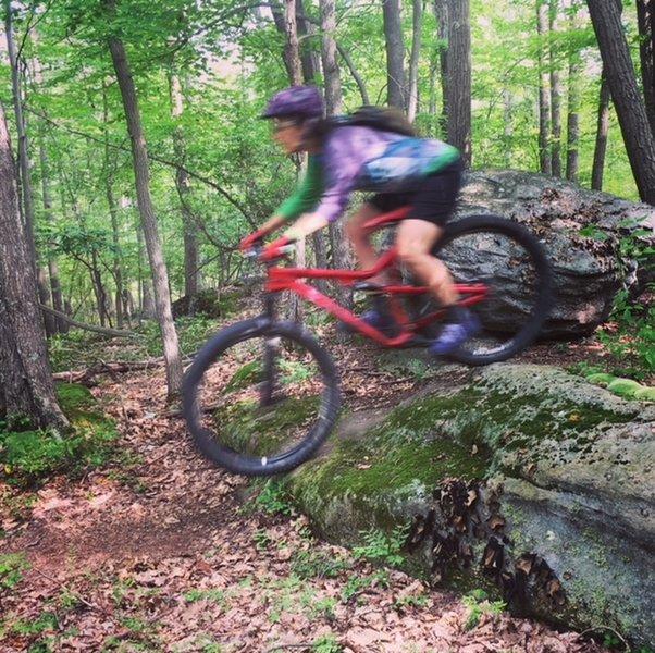 J. sends it off a Crack Trail rock.