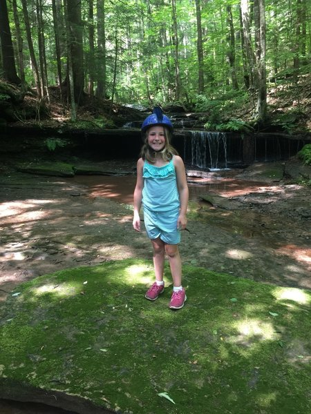 From training wheels to trails - taking a break next to the falls on Thomas Reserve