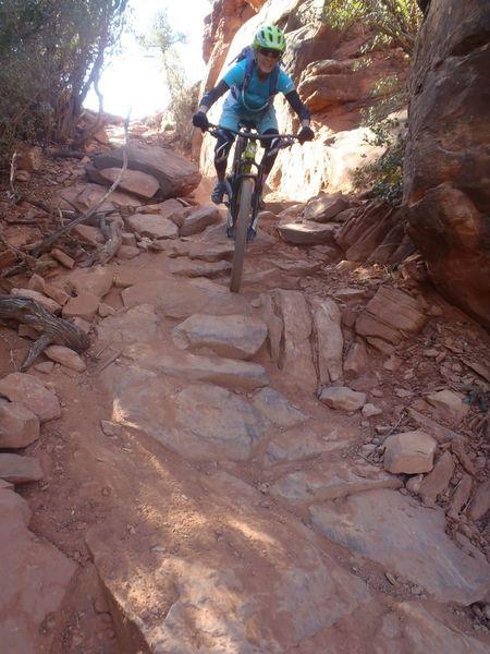 Liz shreds a rock chute