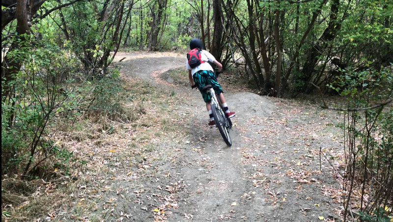 Cruising into the next berm on the Lower Coal Camp Descent.