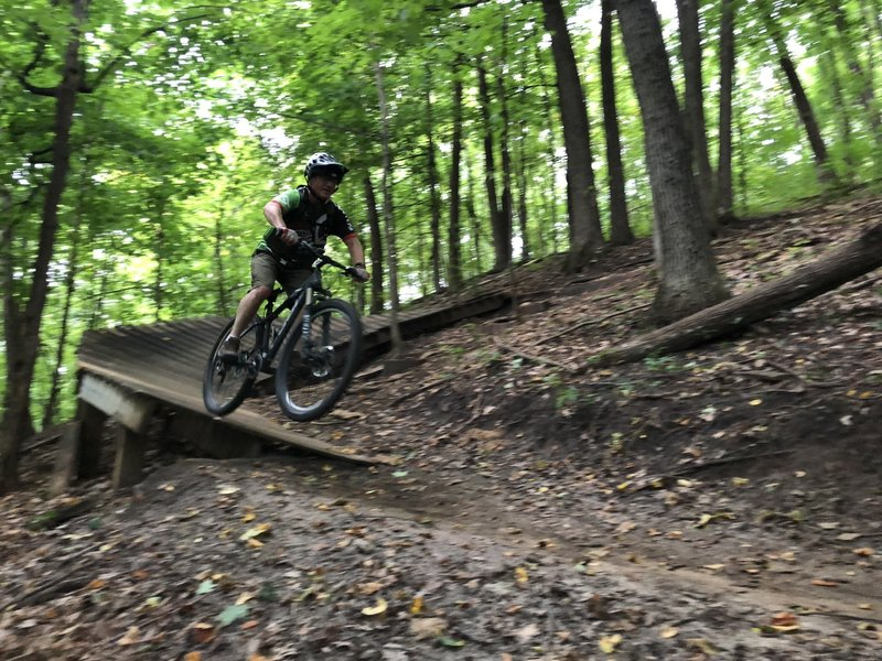 Riding the wood berm to a small drop is no problem, even if you're 60 Plus!
