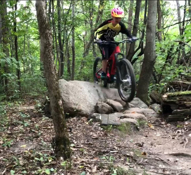 Riding one of the larger Rock pile features on this trail System!