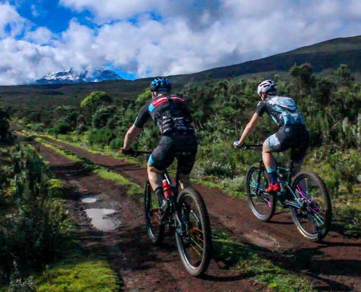 Pro team Thomas Turner and Gordon Wadsworth (right) climbing Kilimanjaro in the 2018 MTB Stage Race.  They would go on to win the duo division while setting every course record imaginable.