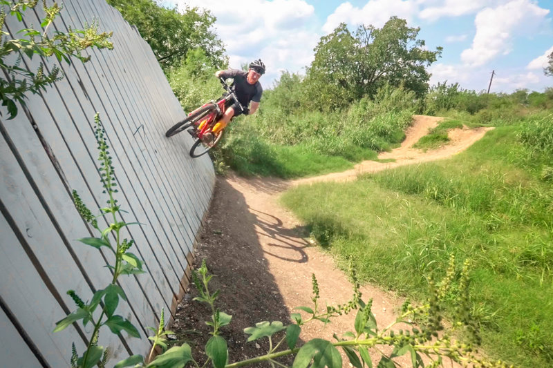 Riding up the wall at the pump track.