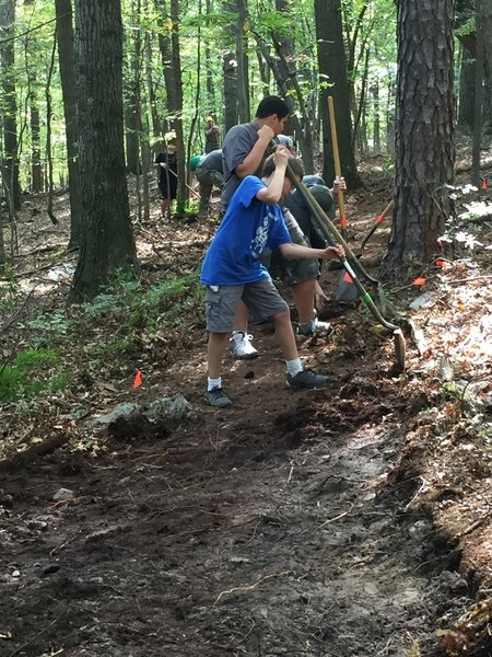 Boy Scouts working with bike and trail running group putting in the work for a great trail!