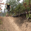"""Ripping the """"new"""" trail.  First time down it and diggin it.  Lots of sweet berms and tables."""