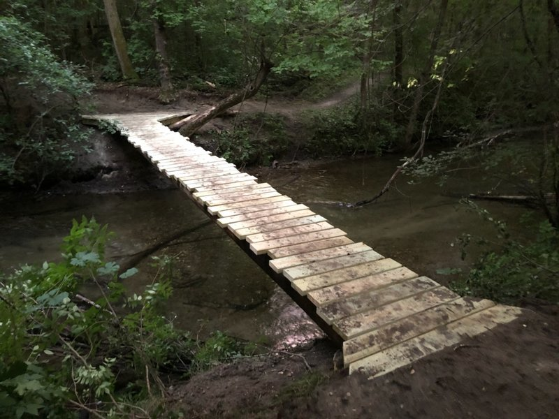 Bridge across Otter Creek - cross to ride all the way around the lakes, or stay on South bank to ride back on the East side of park