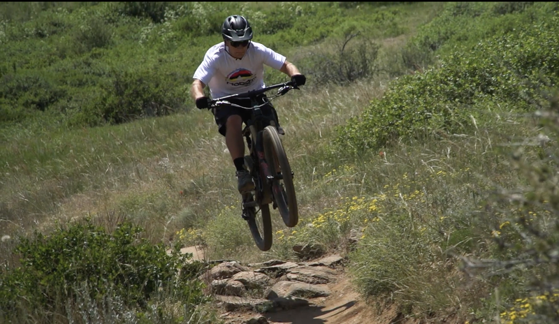 Sending it on lower Chimney Gulch Trail.