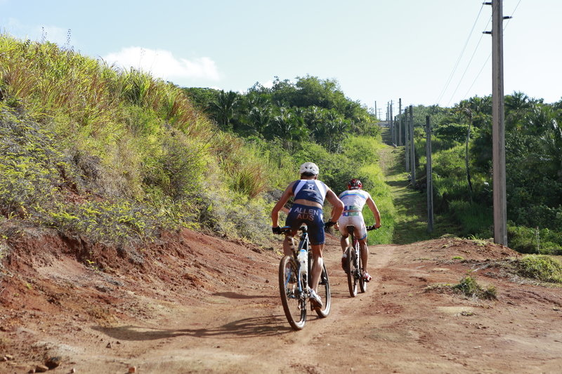 Pro XTERRA athletes, Ben Allen and Dan Hugo, follow the Power Line trail up the Grass Wall climb. Photo by Takamitsu Usami