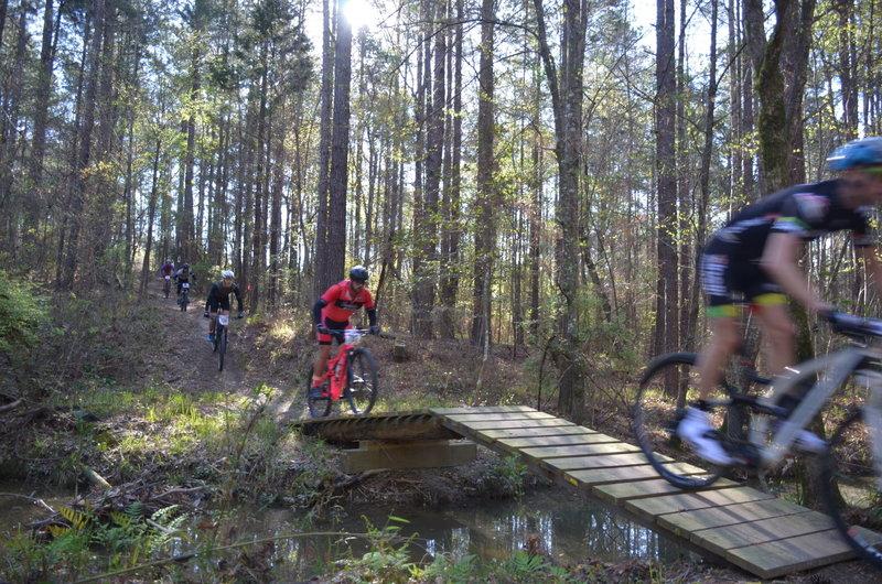 racing over the Big Enoch creek jump