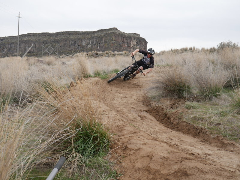 Hitting a berm on the flow trail