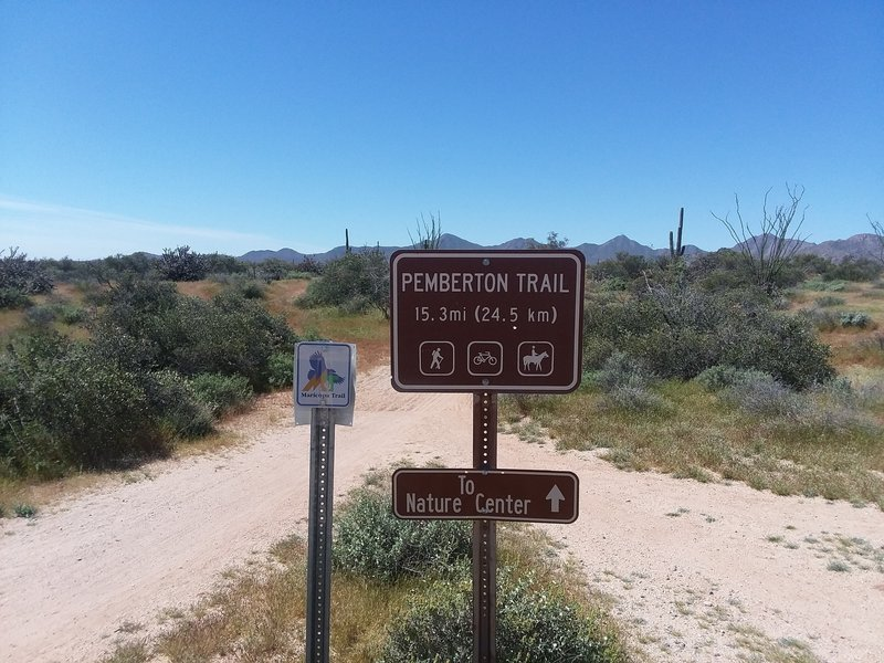 This sign is at the start of the parking lot. Ride the trail in a clockwise loop for fun downhills coming back.