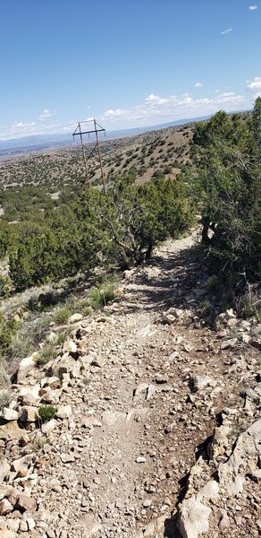 First drop after a long climb from the parking lot.  Lots of loose rocks and tight turns ahead.