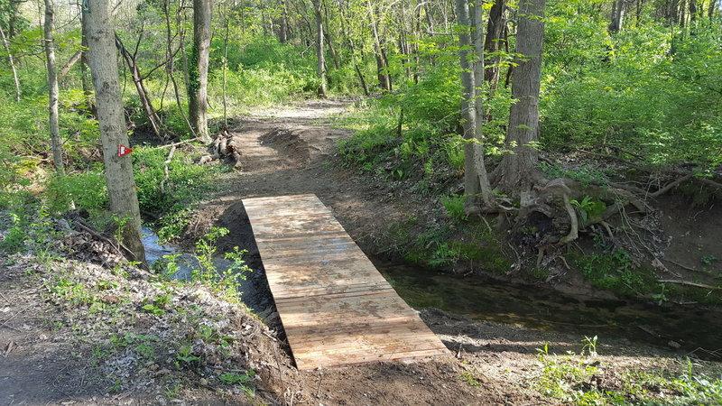 New bridge over creek by pipeline trail