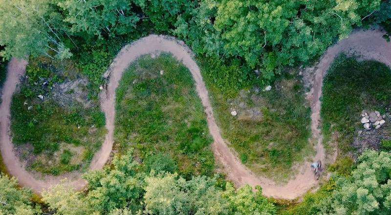 Green trail downhill serpentine