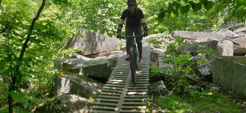Riding the exit bridge over the granite debris field at start of Roller Coaster.
