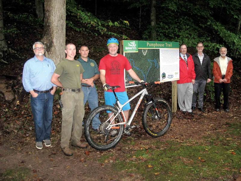 Mountwood Park land managers, trail promoters, trail volunteers ,and Chris McKee of McKee Foods (second from right) at the Pumphouse Trail dedication.