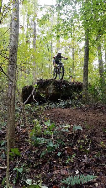 Launching a big rock drop along the Jackson Run Trail!