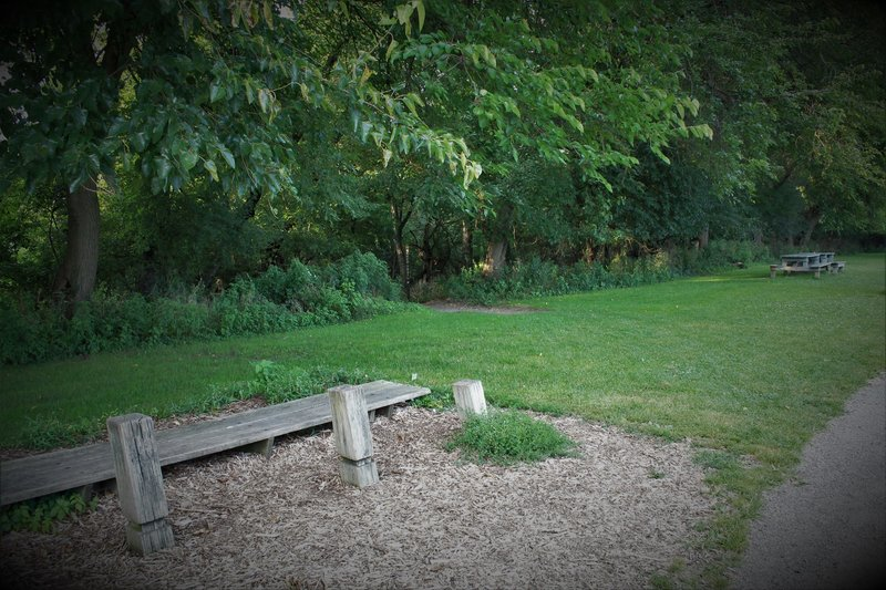 """The entrance near Blue Slide is off the paved trail between the bench and picnic table. Trailhead is marked """"Bench"""" but splits shortly below..."""