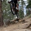 Fun drop following a rock garden at the beginning of an awesome flowing downhill section.