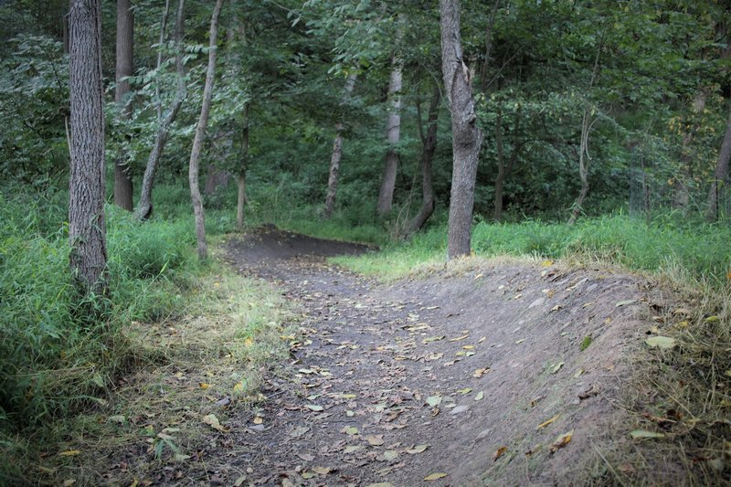Two berms back-to-back can be ridden while pumping before continuing the descent.