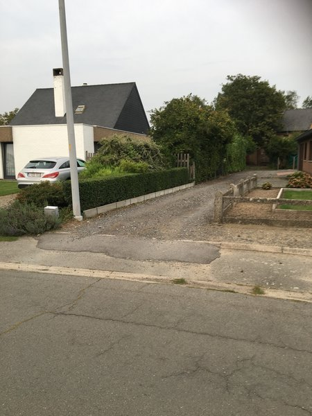 Yes, looks strange, but this is the right direction to follow. You enter the gravel path next to a house .