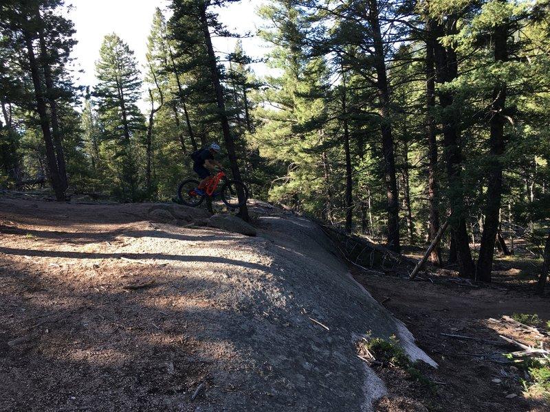 Evan launching off rock.