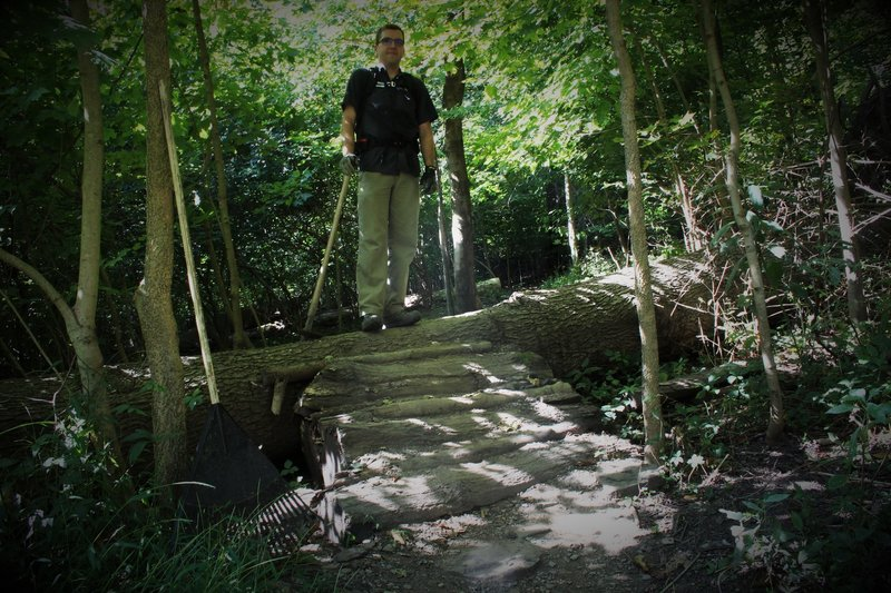 This trail has numerous technical trail features, including log piles of various size.  Trail fairy for scale.