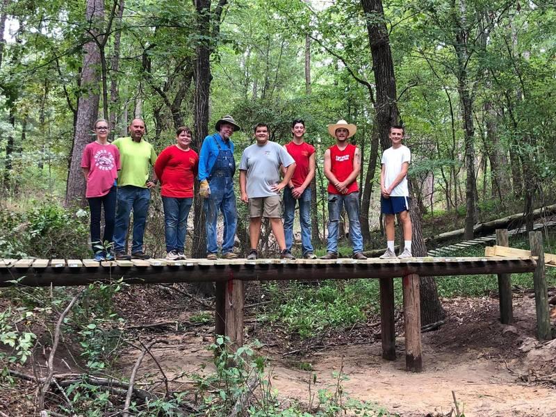 A local Boy Scout crew building a new bridge on Buzzard Hallow.