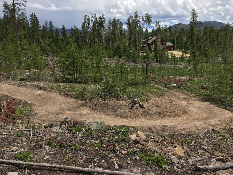 A pair of bermed turns on Moose Meander bike loop