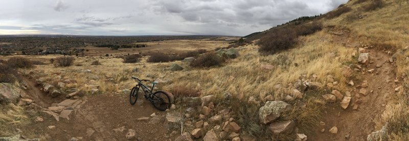 Rock garden section on the descent of Maxwell trail, small rock steps to left and right of the bike pictured.