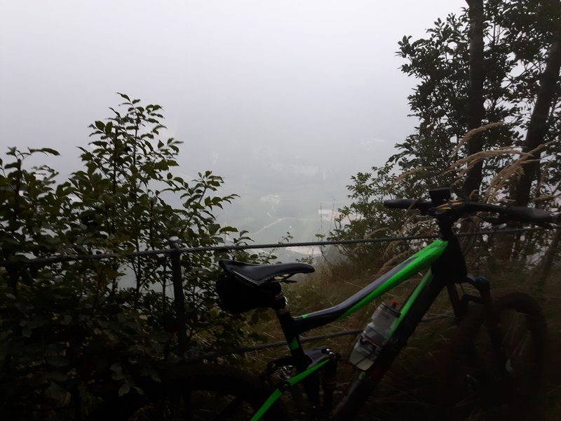 In the dust of the morning: high above the town of Nago. The trail is leading just beside the rim here.