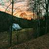 Sunset view of mountains, trees and church near lower trailhead and parking spot
