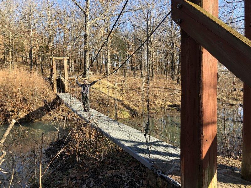 swinging bridge over the lake