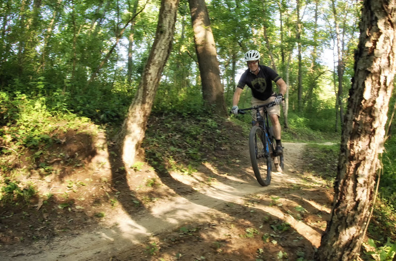 Rider enjoying some pumpy bench cut trail at Creekside.