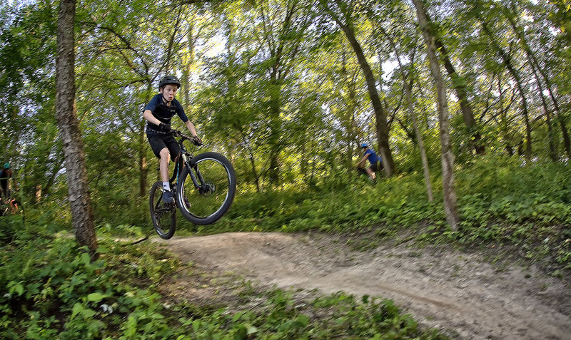 Youth rider launching a roller at Creekside.