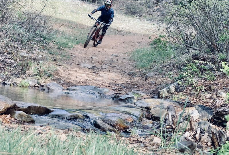 Crossing the creek at the bottom - almost done with the downhill.