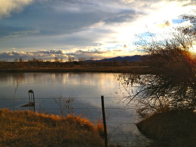 Looking West towards the flatirons from the White Rocks section of the East Boulder Trail.  These peaceful ponds were reclaimed from an old gravel mining operation.