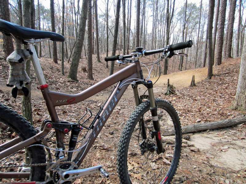 My bike stares wistfully down the trail, dreaming of sweeping berms and catching air with reckless abandon.