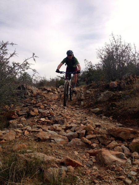 Ryan shredding some some rocky terrain at Red Hills
