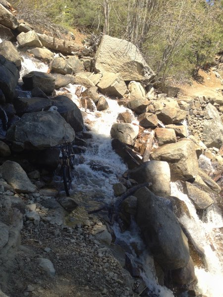 Spring riding in South Lake Tahoe.. the snow melt overflowing the trail!