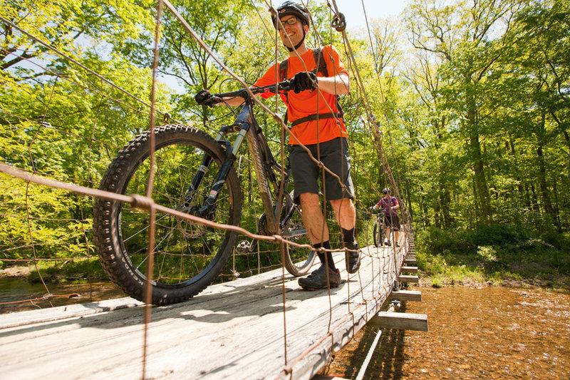 Crossing the swing bridge at the bottom of Brushy Hollow
