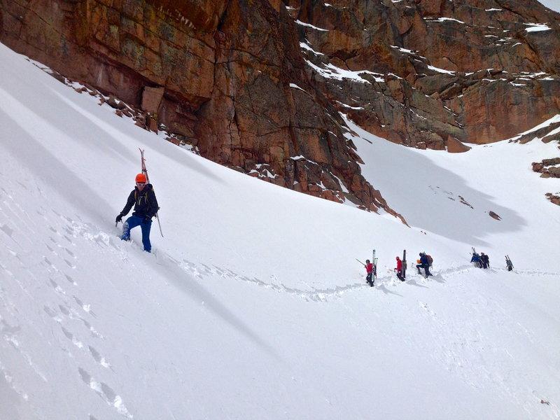 Traversing the large snow apron below the Corinthian Column.