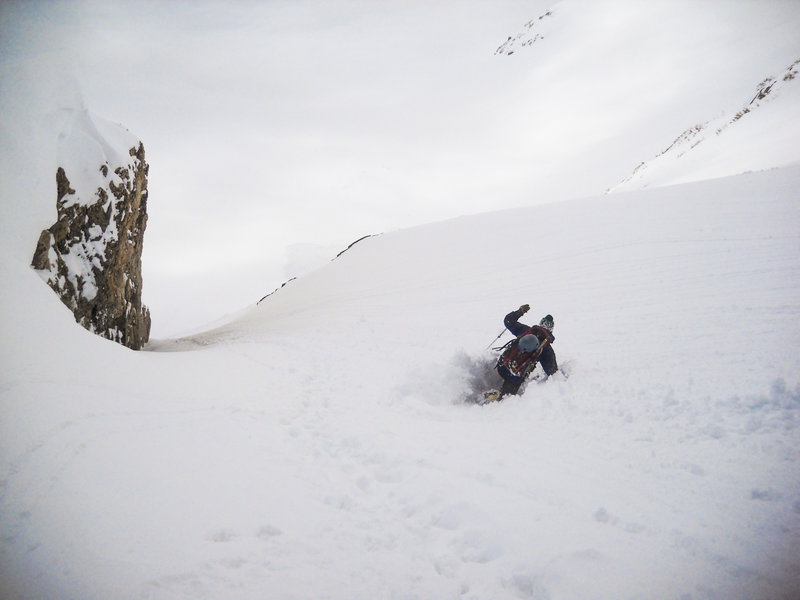 "Descending the ""Exit Couloir"" in sloppy spring conditions. A line out on the face to the right is passable in all but the most meager snow years as well."