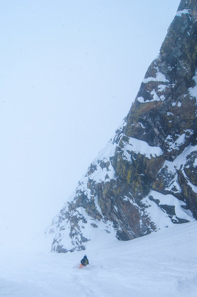Storm skiing in the lower portion of the couloir