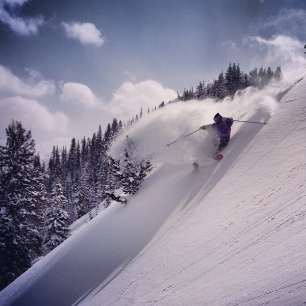 Evan Melquist slashing some powder just below the peak!