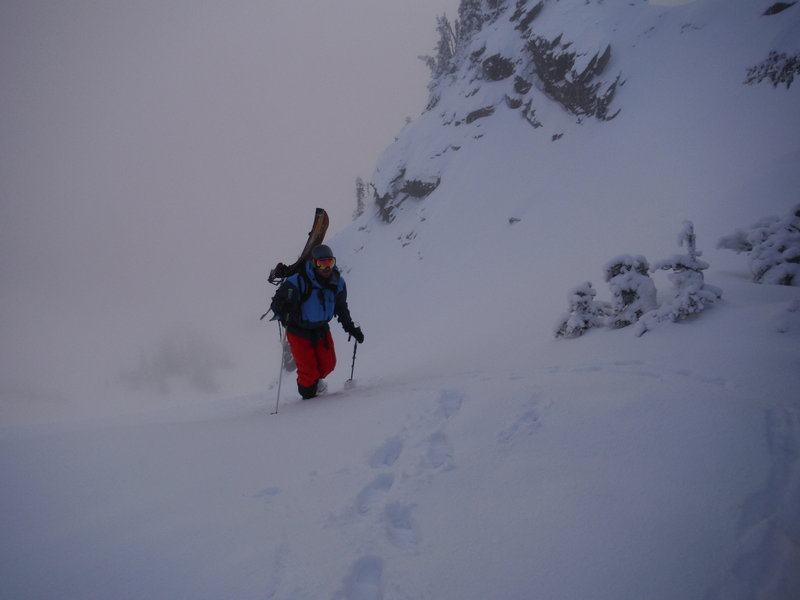 Hiking to get some socked in sunrise turns. Can be a little too steep to switch back in some conditions, but usually you can lay a track down.